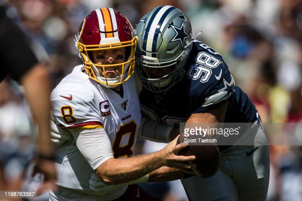 Tyrone Crawford of the Dallas Cowboys sacks Case Keenum of the Washington Redskins during the first half at FedExField on September 15 2019 in...