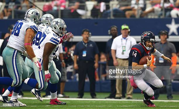 Tyrone Crawford of the Dallas Cowboys, Terrell McClain of the Dallas Cowboys and George Selvie of the Dallas Cowboys chase Ryan Fitzpatrick of the...