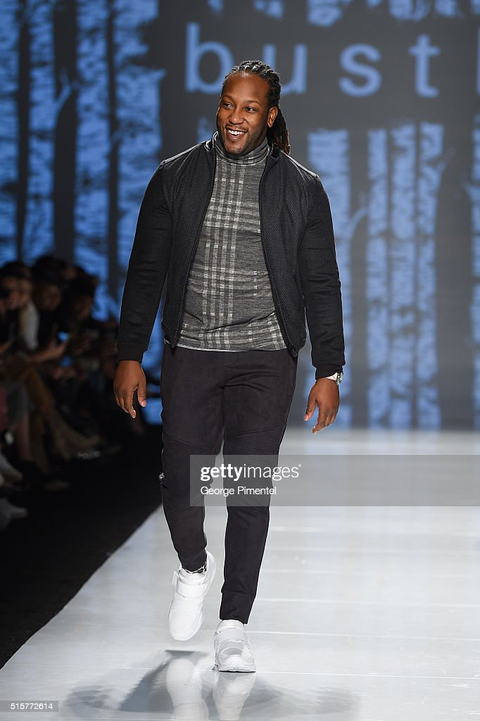 Tyrone Edwards walks the runway wearing Bustle 2016 collection during Toronto Fashion Week Fall 2016 at David Pecaut Square on March 15, 2016 in Toronto, Canada.