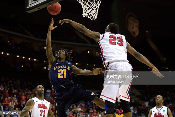 Tyrone Garland of the La Salle Explorers makes the gamewinnng shot in the second half against Reginald Buckner of the Mississippi Rebels during the...