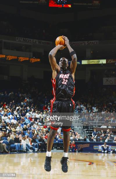 Tyrone Hill of the Miami Heat shoots an open jumper during the game against the Golden State Warriors at the Arena in Oakland on November 21 2003 in...