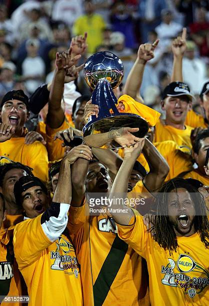 Tyrone Marshall and Cobi Jones of the Los Angeles Galaxy hoist the Alan I. Rothenberg trophy after defeating the New England Revolution 1-0 in...
