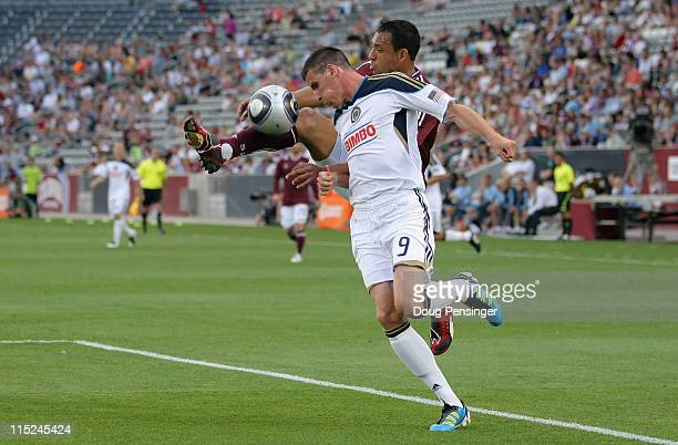 Tyrone Marshall of the Colorado Rapids clears the ball away from Sebastien Le Toux of the Philadelphia Union at Dick's Sporting Goods Park on June 4...