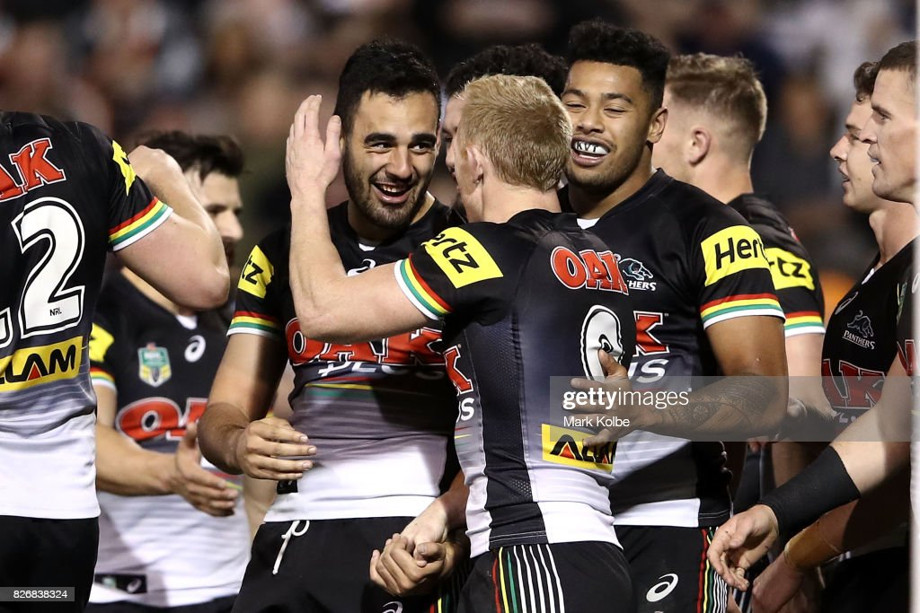 Tyrone May of the Pannthers celebrates with his team mates after scoring a try during the round 22 NRL match between the Penrith Panthers and the Wests Tigers at Pepper Stadium on August 6, 2017 in Sydney, Australia.