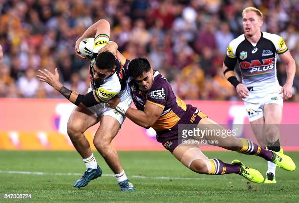 Tyrone May of the Panthers attempts to break away from the defence during the NRL Semi Final match between the Brisbane Broncos and the Penrith...