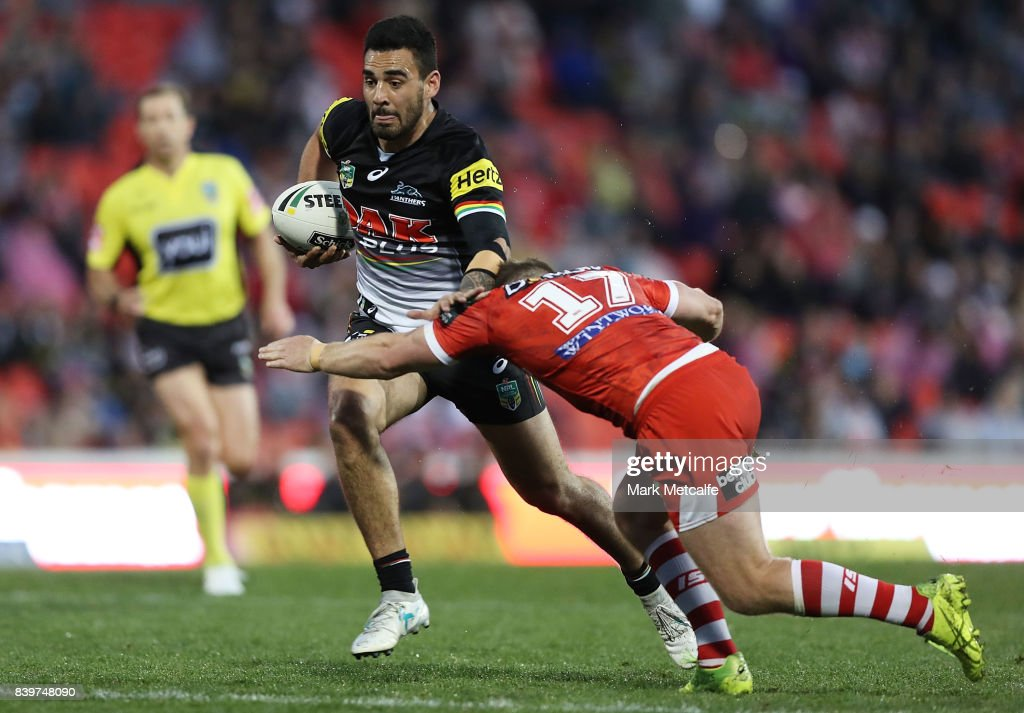 Tyrone May of the Panthers is tackled by Josh McCrone of the Dragons during the round 25 NRL match between the Penrith Panthers and the St George Illawarra Dragons at Pepper Stadium on August 27, 2017 in Sydney, Australia.