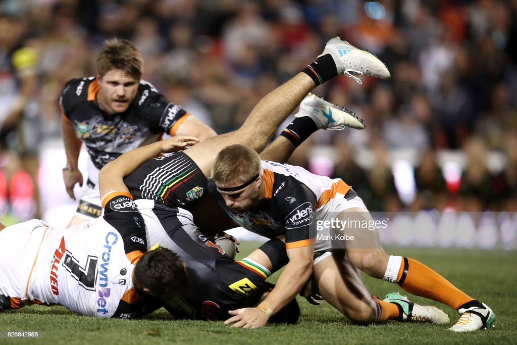 Tyrone May of the Panthers is tackled during the round 22 NRL match between the Penrith Panthers and the Wests Tigers at Pepper Stadium on August 6, 2017 in Sydney, Australia.