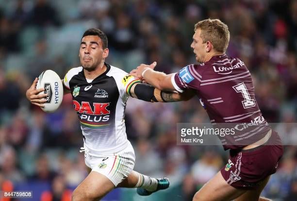 Tyrone May of the Panthers puts a fend on Tom Trbojevic of the Sea Eagles during the NRL Elimination Final match between the Manly Sea Eagles and the...