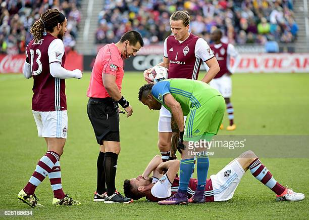 Tyrone Mears of Seattle Sounders consoles Sebastien Le Toux of Colorado Rapids during the firsst half at Dick's Sporting Goods Park on November 27...