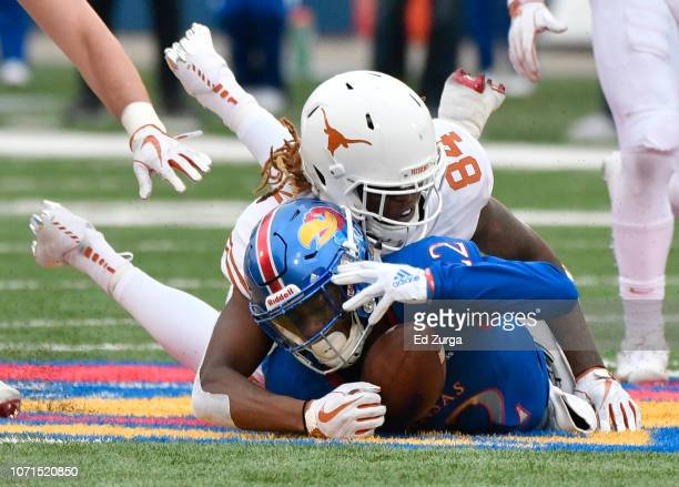 Tyrone Miller Jr #22 of the Kansas Jayhawks recovers the ball on an onsidekick against Lil'Jordan Humphrey of the Texas Longhorns in fourth quarter...