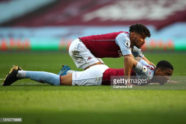 Tyrone Mings and Ezri Konsa of Aston Villa react during the Premier League match between Aston Villa and Fulham at Villa Park on April 04, 2021 in...