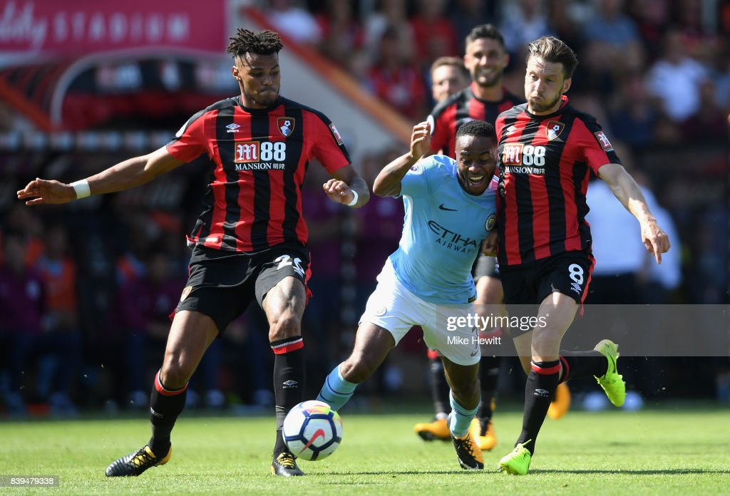 Tyrone Mings of AFC Bournemouth and Harry Arter of AFC Bournemouth foul Raheem Sterling of Manchester City during the Premier League match between AFC Bournemouth and Manchester City at Vitality Stadium on August 26, 2017 in Bournemouth, England.