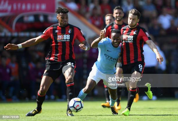 Tyrone Mings of AFC Bournemouth and Harry Arter of AFC Bournemouth foul Raheem Sterling of Manchester City during the Premier League match between...