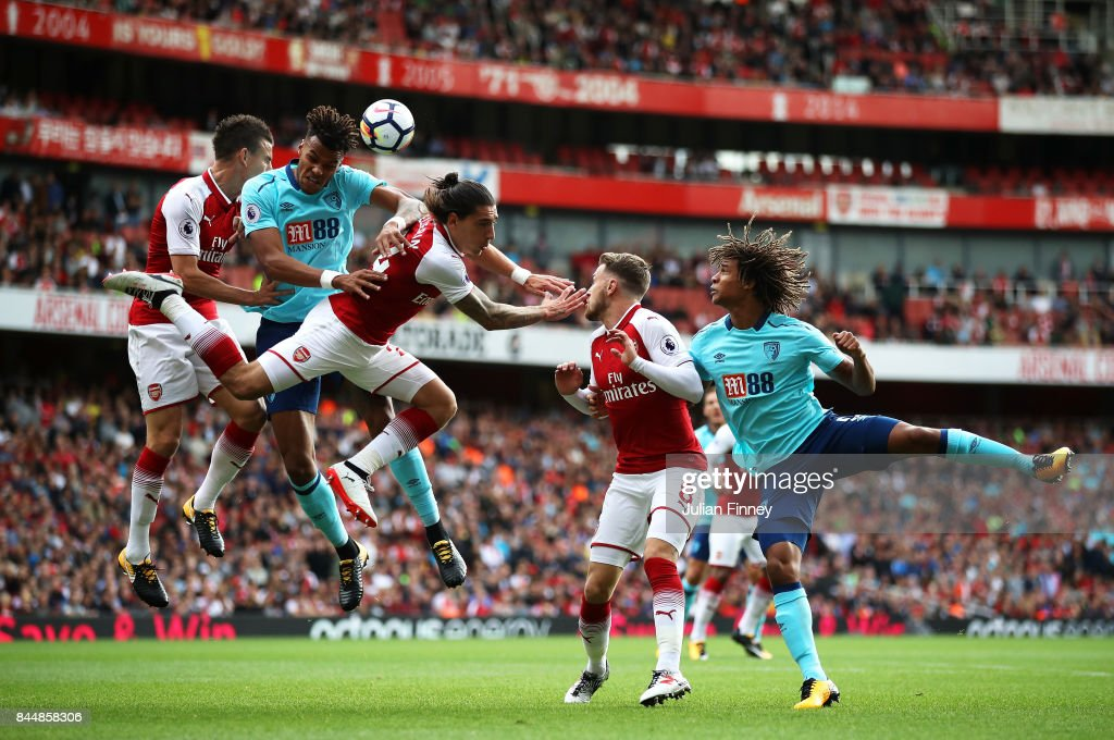 Tyrone Mings of AFC Bournemouth and Hector Bellerin of Arsenal battle for possession in the air during the Premier League match between Arsenal and AFC Bournemouth at Emirates Stadium on September 9, 2017 in London, England.