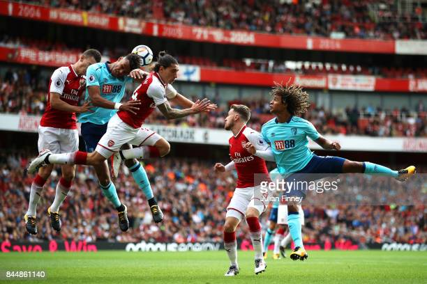 Tyrone Mings of AFC Bournemouth and Hector Bellerin of Arsenal battle for possession in the air during the Premier League match between Arsenal and...