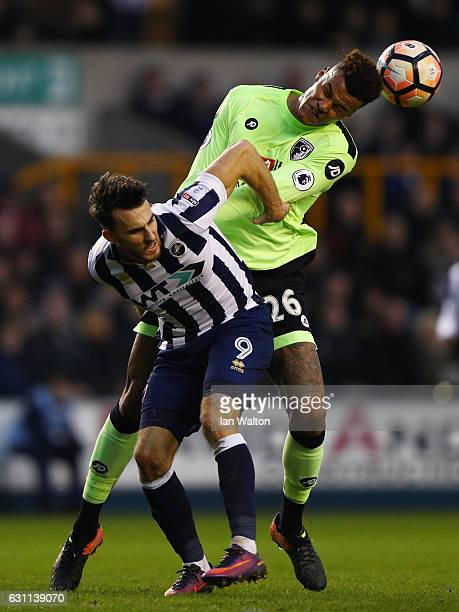 Tyrone Mings of AFC Bournemouth and Lee Gregory of Millwall in action during the Emirates FA Cup third round match between Millwall and AFC...