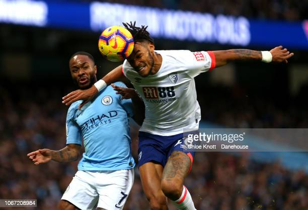 MANCHESTER ENGLAND DECEMBER 01 Tyrone Mings of AFC Bournemouth and Raheem Sterling of Manchester City in action during the Premier League match...