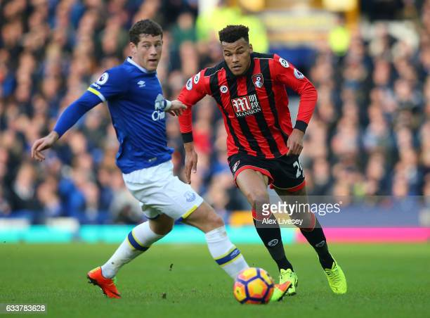Tyrone Mings of AFC Bournemouth and Ross Barkley of Everton compete for the ball during the Premier League match between Everton and AFC Bournemouth...