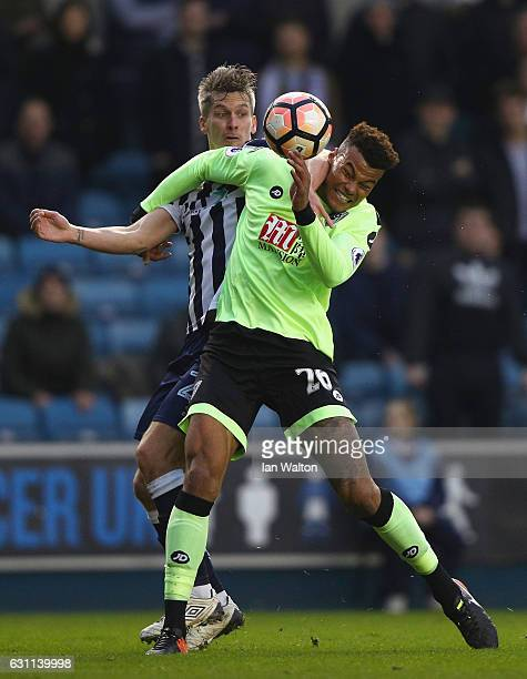 Tyrone Mings of AFC Bournemouth and Shaun Hutchinson of Millwall compete for the ball during the Emirates FA Cup third round match between Millwall...