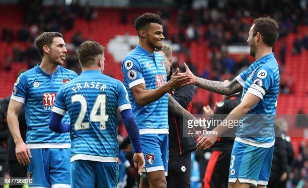 Tyrone Mings of AFC Bournemouth celebrates with Steve Cook of AFC Bournemouth after the Premier League match between Manchester United and AFC...