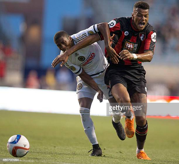 Tyrone Mings of AFC Bournemouth dribbles the ball past Ray Gaddis of the Philadelphia Union on July 14 2015 at the PPL Park in Chester Pennsylvania...