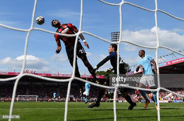 Tyrone Mings of AFC Bournemouth heads the ball off the line during the Premier League match between AFC Bournemouth and Manchester City at Vitality...