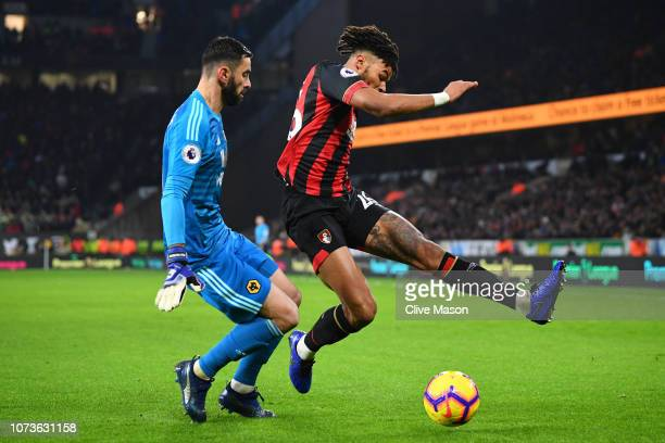 Tyrone Mings of AFC Bournemouth is challenged by Rui Patricio of Wolverhampton Wanderers during the Premier League match between Wolverhampton...