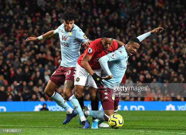 Tyrone Mings of Aston Villa and Ezri Konsa Ngoyo of Aston Villa battles for possession with Anthony Martial of Manchester United during the Premier...