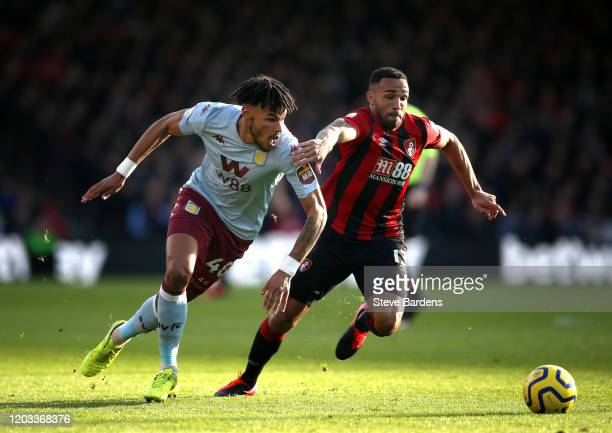 Tyrone Mings of Aston Villa battles for possession with Callum Wilson of AFC Bournemouth during the Premier League match between AFC Bournemouth and...