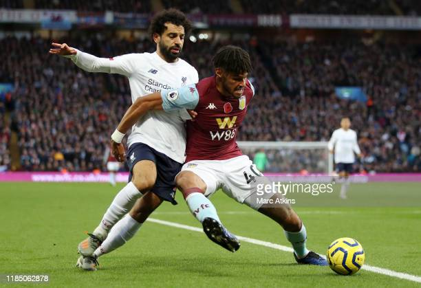 Tyrone Mings of Aston Villa battles for possession with Mohamed Salah of Liverpool during the Premier League match between Aston Villa and Liverpool...