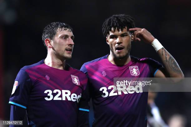 Tyrone Mings of Aston Villa chats with team mate Tommy Elphick during the Sky Bet Championship match between Brentford and Aston Villa at Griffin...