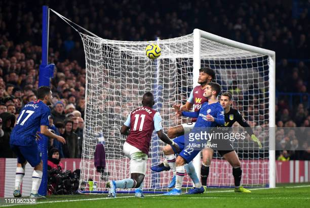 Tyrone Mings of Aston Villa clears away from Christian Pulisic of Chelsea during the Premier League match between Chelsea FC and Aston Villa at...