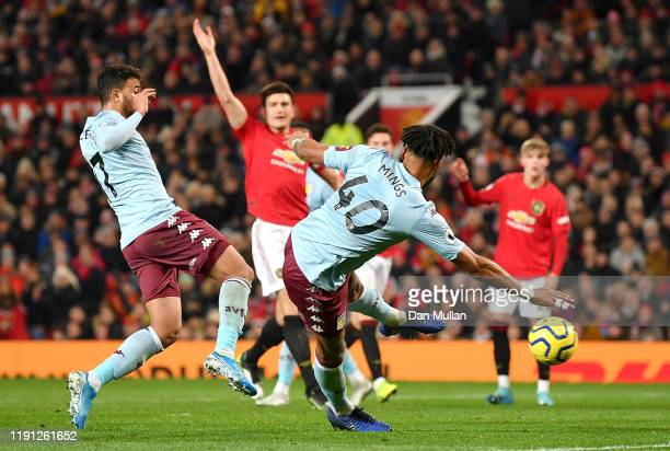 Tyrone Mings of Aston Villa scores his sides second goal during the Premier League match between Manchester United and Aston Villa at Old Trafford on...