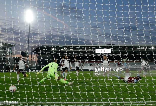 Tyrone Mings of Aston Villa scores his team's third goal past Alphonse Areola of Fulham during the Premier League match between Fulham and Aston...