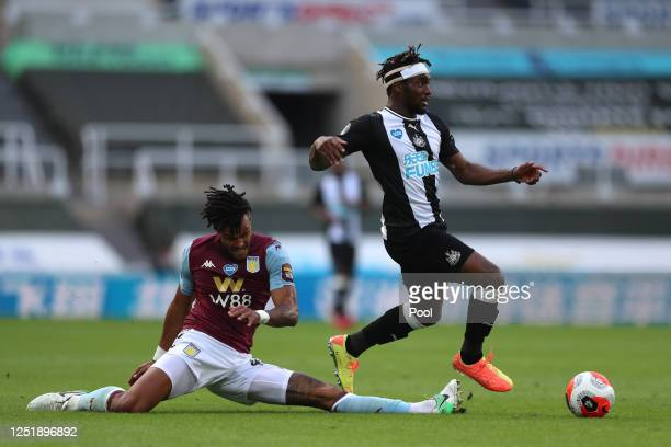 Tyrone Mings of Aston Villa tackles Allan Saint-Maximin of Newcastle United during the Premier League match between Newcastle United and Aston Villa...
