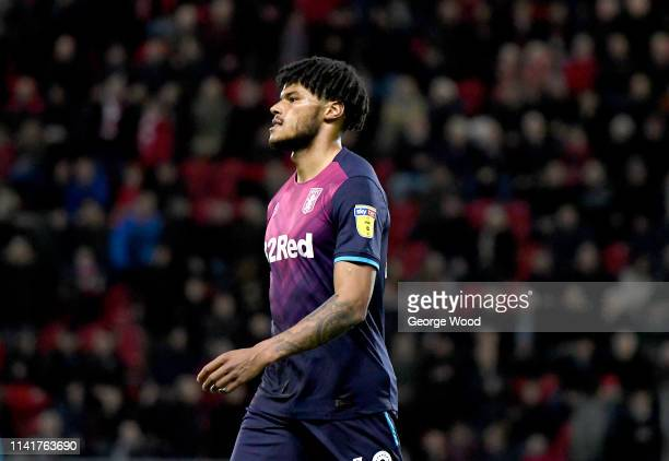 Tyrone Mings of Aston Villa walks off dejected after being sent off during the Sky Bet Championship match between Rotherham United and Aston Villa at...