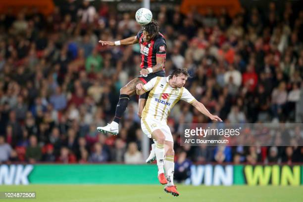 Tyrone Mings of Bournemouth and Alex Gilbey of Milton Keynes Dons during the Carabao Cup Second Round match between AFC Bournemouth and Milton Keynes...