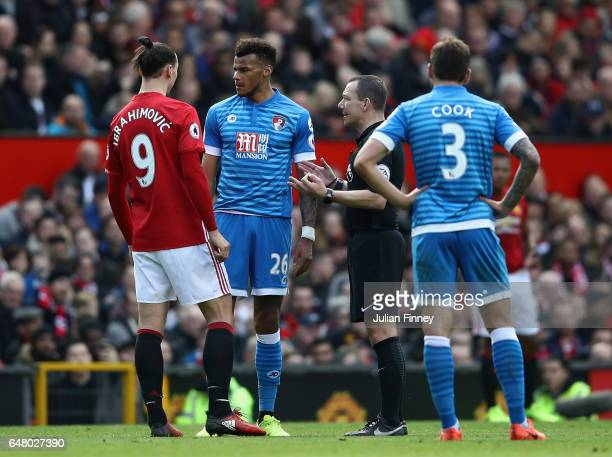 Tyrone Mings of Bournemouth and Zlatan Ibrahimovic of Manchester United clash during the Premier League match between Manchester United and AFC...