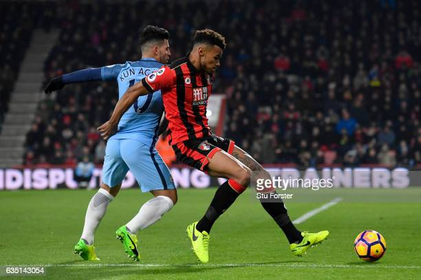 Tyrone Mings of Bournemouth battles for the ball with Sergio Aguero of Manchester City during the Premier League match between AFC Bournemouth and...
