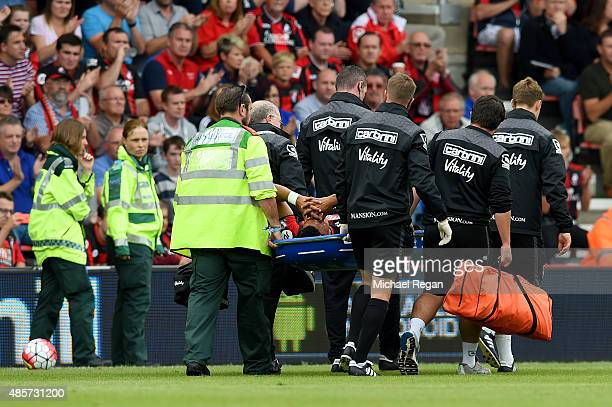 Tyrone Mings of Bournemouth is taken off the pitch by stretcher after picking up injury during the Barclays Premier League match between AFC...