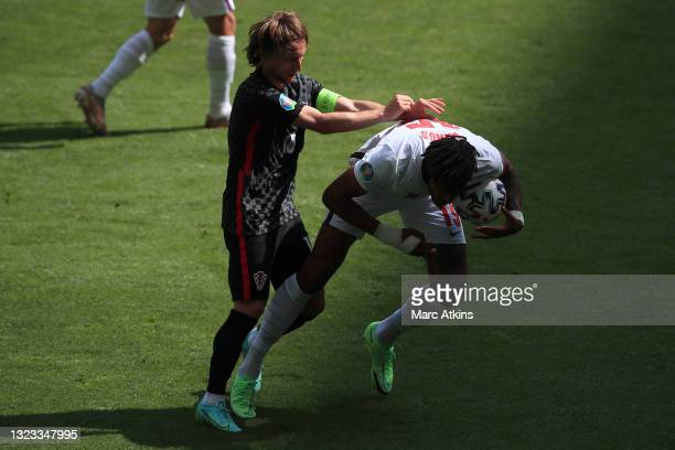 Tyrone Mings of England is challenged by Luka Modric of Croatia during the UEFA Euro 2020 Championship Group D match between England and Croatia at...