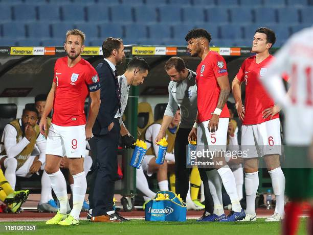 Tyrone Mings of England speaks with Gareth Southgate, Manager of England during the UEFA Euro 2020 qualifier between Bulgaria and England on October...