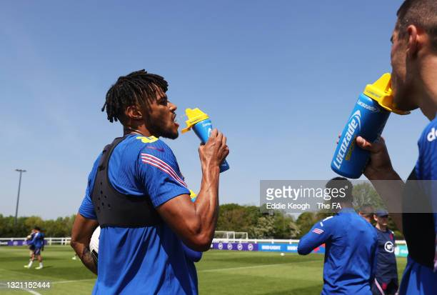 Tyrone Mings of England takes a drink from a Lucozade bottle during a training session at an England Pre-Euro 2020 Training Camp on June 01, 2021 in...