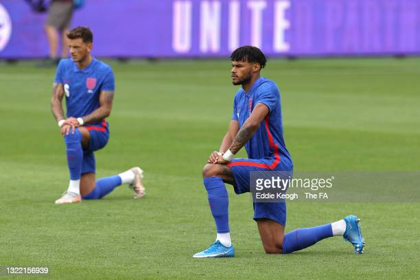 Tyrone Mings of England takes a knee in support of the Black Lives Matter movement prior to the international friendly match between England and...