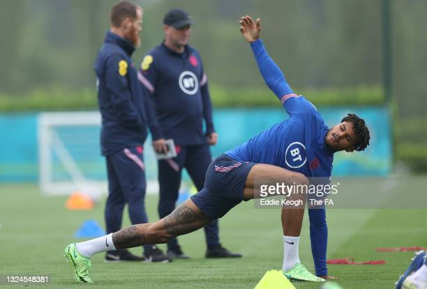 Tyrone Mings of England warms up during the England Training Session at Tottenham Hotspur Training Ground on June 20, 2021 in Burton upon Trent,...
