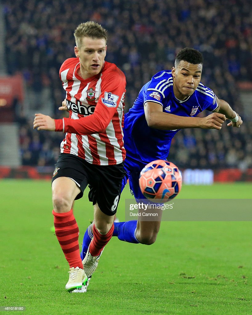 Tyrone Mings of Ipswich Town chases Steven Davis of Southampton during the FA Cup Third Round match between Southampton and Ipswich Town at St Mary's Stadium on January 4, 2015 in Southampton, England.