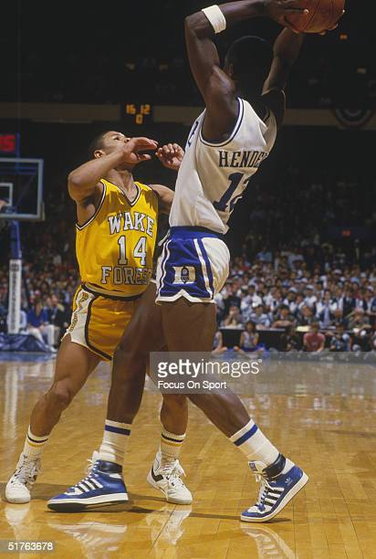 Tyrone Mugsy Bogues of Wake Forest College defends a Duke University player in a game against during the 1980s