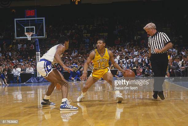 Tyrone Mugsy Bogues of Wake Forest College looks to move against a player for Duke University during the 1980s