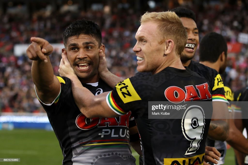 Tyrone Peachey and Peter Wallace of the Panthers celebrate victory during the round 10 NRL match between the Penrith Panthers and the New Zealand Warriors at Pepper Stadium on May 13, 2017 in Sydney, Australia.