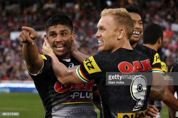 Tyrone Peachey and Peter Wallace of the Panthers celebrate victory during the round 10 NRL match between the Penrith Panthers and the New Zealand...
